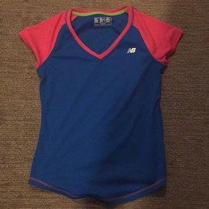 Women's medium new balance workout shirt.